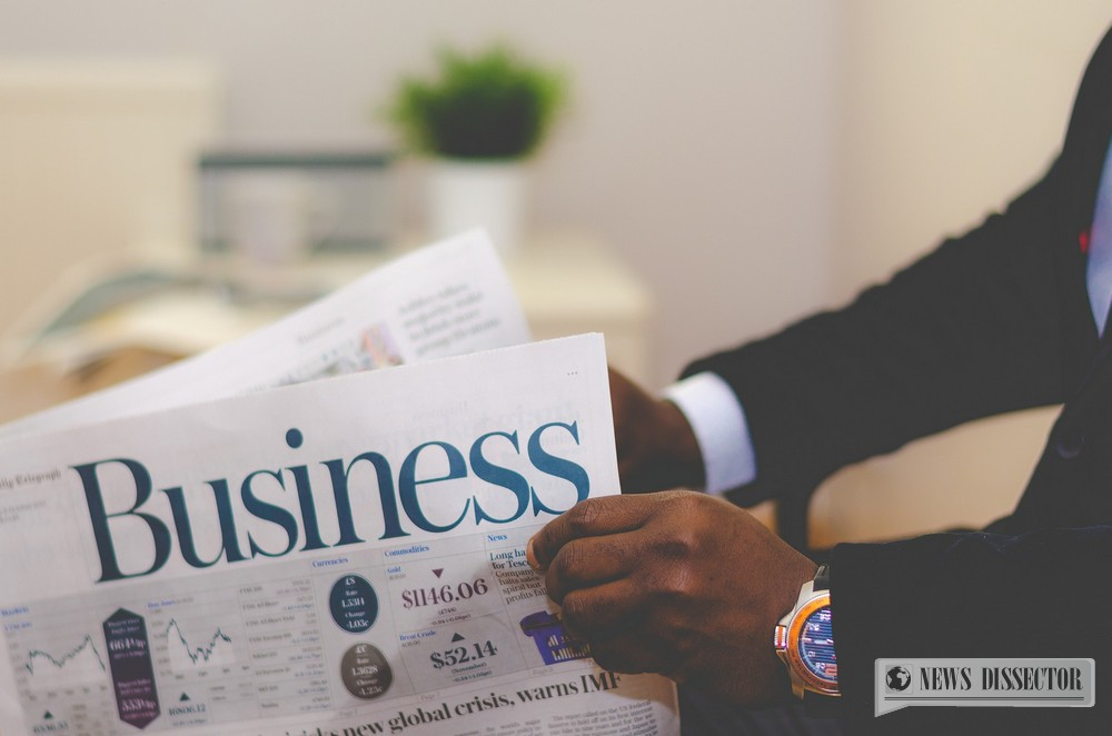 A man reading a business paper