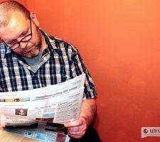 A man reading a newspaper