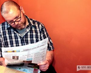 A man reading a newspaper
