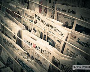 A rack of German newspapers