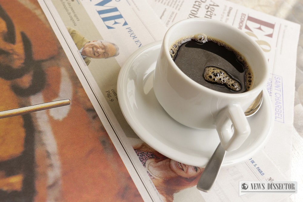 Newspaper with a cup of coffee